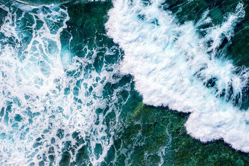 Rough sea waves splashing near a rocky seabed 1158825869