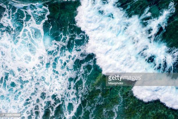 rough sea waves splashing near a rocky seabed - sea stock pictures, royalty-free photos & images
