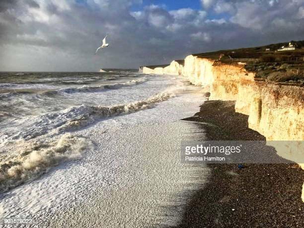 rough seas eroding chalk cliffs - beachy head stock photos and pictures