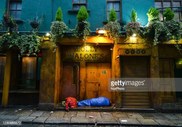 Rough sleeper seen at the entrance to a closed Molly Malones pub in Temple Bar, Dublin, during Level 5 Covid-19 lockdown. On Saturday, 30 January in...