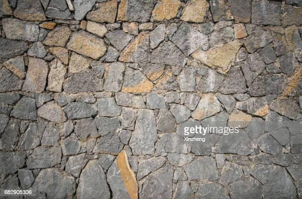 rough stone wall texture, stones background, stones wall pattern, stone texture background - fortified wall stock photos and pictures
