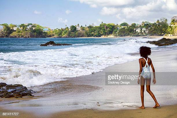 rough surf tobago beach little girl - kids swimsuit models stock pictures, royalty-free photos & images