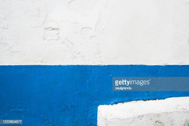 rough wall in white and blue - two tone color stock pictures, royalty-free photos & images
