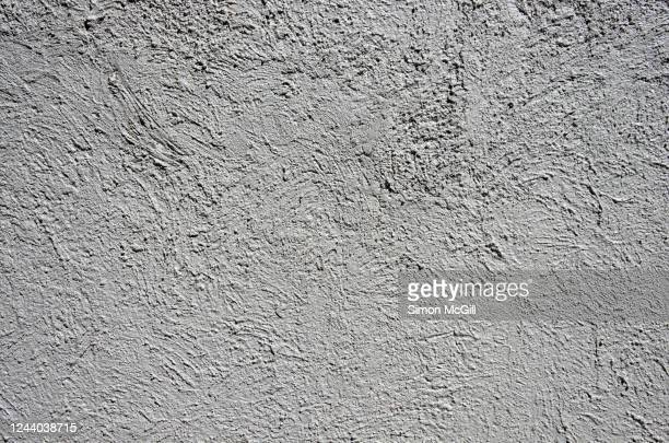 rough whitewashed stucco building exterior wall - whitewashed stock pictures, royalty-free photos & images