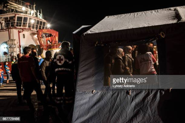 POZZALLO SICILY ITALY SEPTEMBER 15 2014 Roughly 250 refugees from Egypt and Syria among other countries are checked by Doctors Without Borders as...
