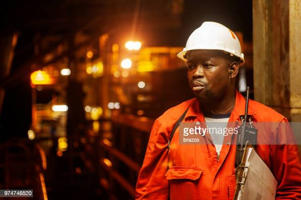roughneck on drilling rig - black jumpsuit stock photos and pictures