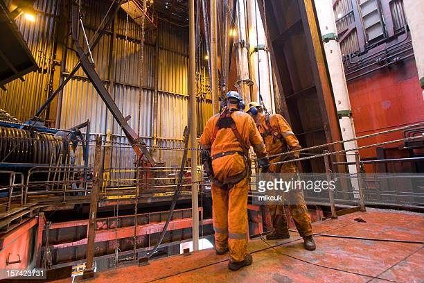 roughnecks working on an oil rig - oil worker stock pictures, royalty-free photos & images