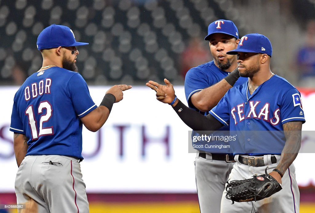 Roughned Odor #12, Delino DeShields #3, and Elvis Andrus #1 (obscured) of the Texas Rangers celebrate after the game against the Atlanta Braves at SunTrust Park on September 4, 2017 in Atlanta, Georgia.