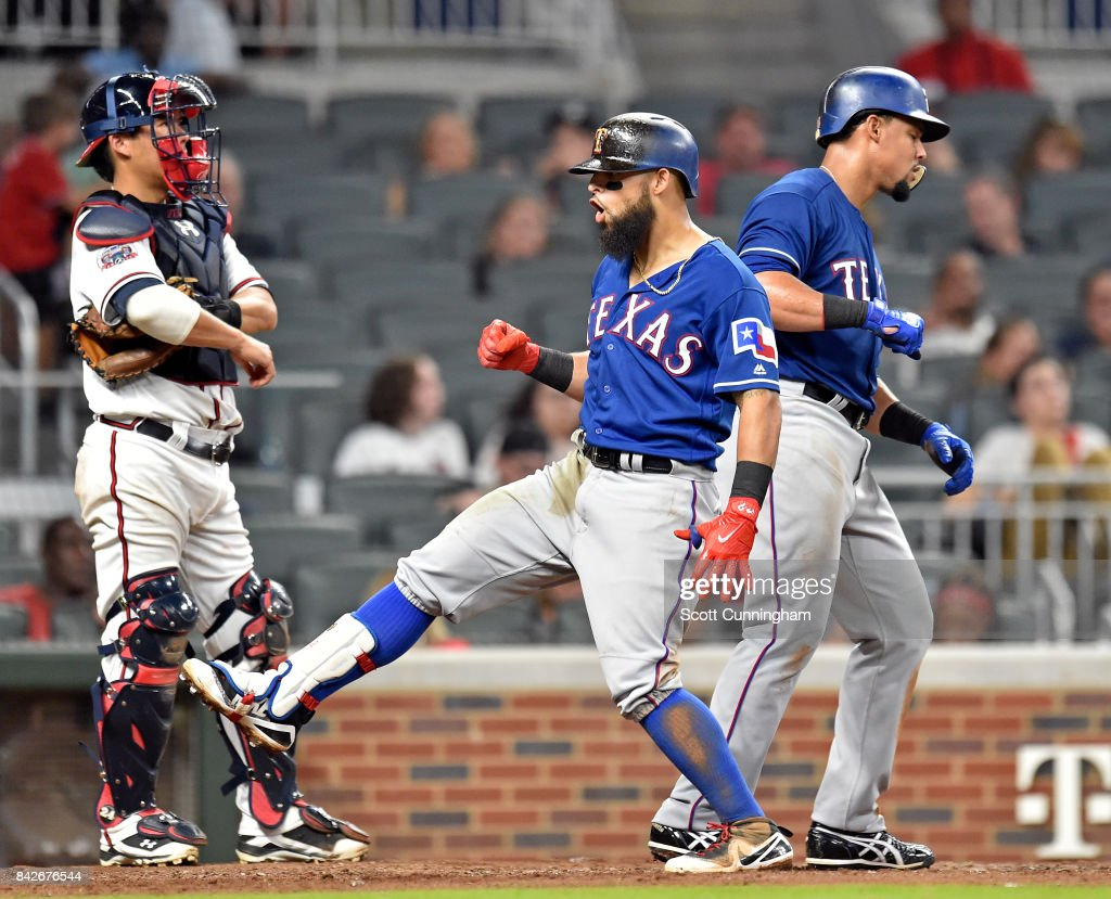 Roughned Odor #12 of the Texas Rangers celebrates after hitting a fifth inning two run home run against the Atlanta Braves at SunTrust Park on September 4, 2017 in Atlanta, Georgia.