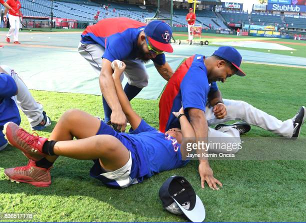 Rougned Odor and Elvis Andrus wrestle with Adrian Beltre Jr the 10 year old son of Adrian Beltre of the Texas Rangers before the game against the Los...