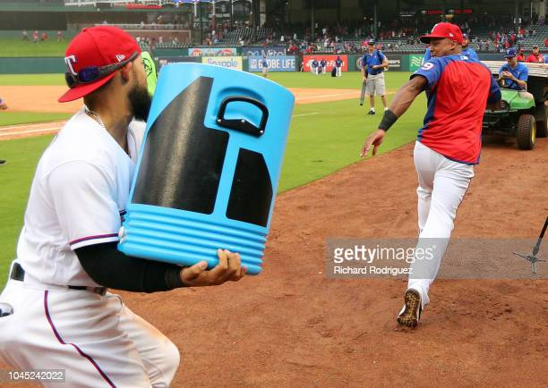 Rougned Odor chases Adrian Beltre of the Texas Rangers with sports drink after the 61 win over the Seattle Mariners at Globe Life Park in Arlington...