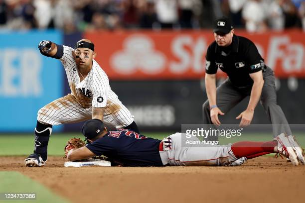 Rougned Odor of the New York Yankees reacts after being called safe at second base ahead of a tag by Xander Bogaerts of the Boston Red Sox in the...