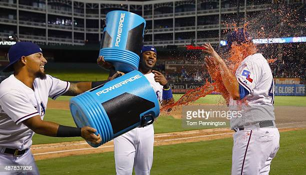 Rougned Odor of the Texas Rangers and Elvis Andrus of the Texas Rangers dump a water cooler on Colby Lewis of the Texas Rangers after the Rangers...