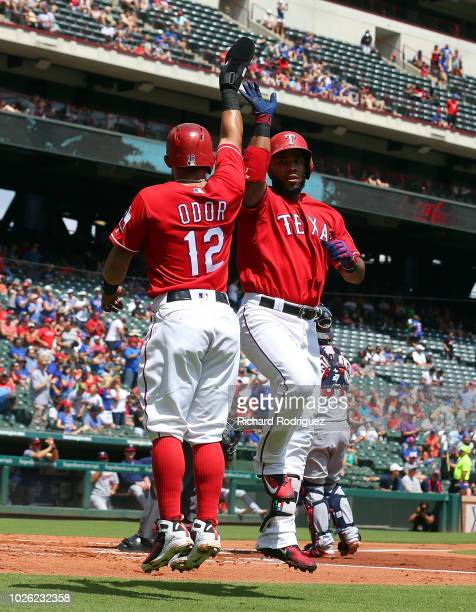 Rougned Odor of the Texas Rangers and Elvis Andrus of the Texas Rangers celebrate Andrus' two-run home run in the first inning of baseball game...
