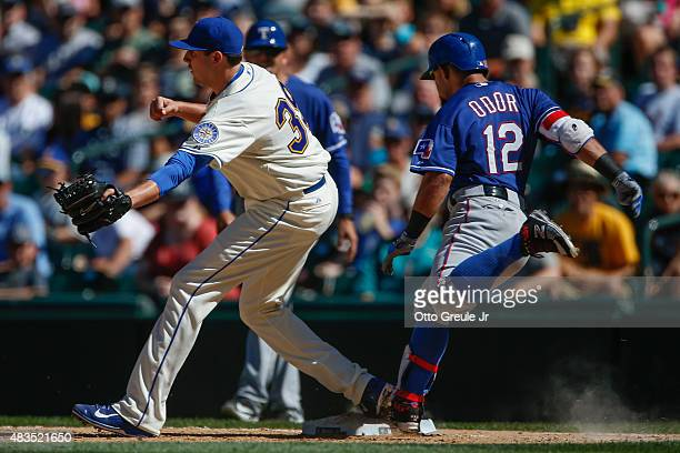 Rougned Odor of the Texas Rangers beats out an infield single against closing pitcher Carson Smith of the Seattle Mariners in the ninth inning at...
