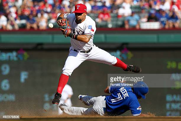 Rougned Odor of the Texas Rangers catches the ball and then drops it as Ben Revere of the Toronto Blue Jays is out at second base on a fielder's...