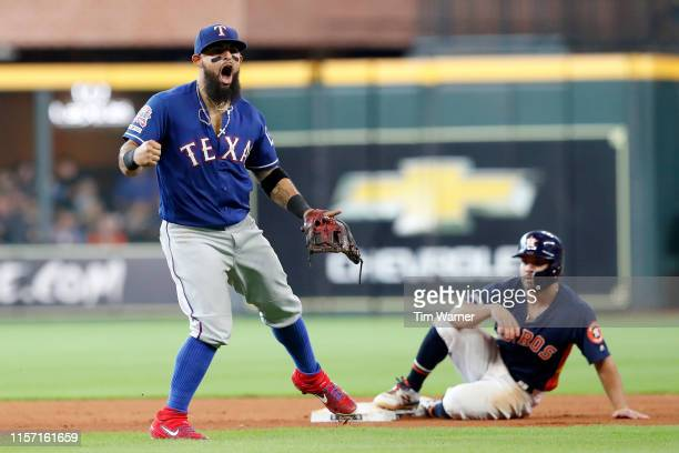 Rougned Odor of the Texas Rangers celebrates after a double play in the seventh inning as Jose Altuve of the Houston Astros reacts at Minute Maid...
