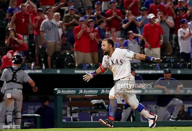 Rougned Odor of the Texas Rangers celebrates after hitting a tworun walkoff homerun against the Seattle Mariners in the bottom of he ninth inning at...