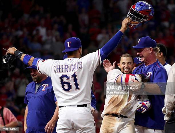 Rougned Odor of the Texas Rangers celebrates with Robinson Chirinos of the Texas Rangers and Steve Buechele of the Texas Rangers after hitting a...