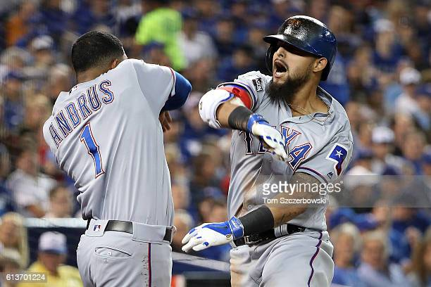 Rougned Odor of the Texas Rangers celebrates with teammate Elvis Andrus hitting a two run home run against the Toronto Blue Jays in the fourth inning...