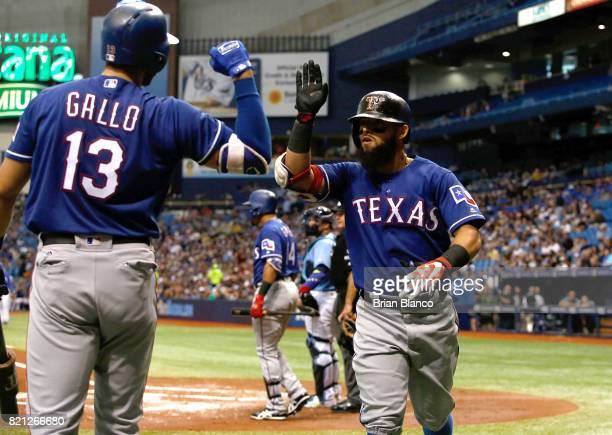 Rougned Odor of the Texas Rangers celebrates with teammate Joey Gallo after hitting a home run off of pitcher Jake Odorizzi of the Tampa Bay Rays...