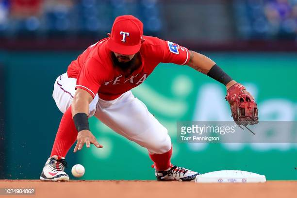 Rougned Odor of the Texas Rangers commits an error fielding the ball against Max Muncy of the Los Angeles Dodgers in the top of the second inning at...