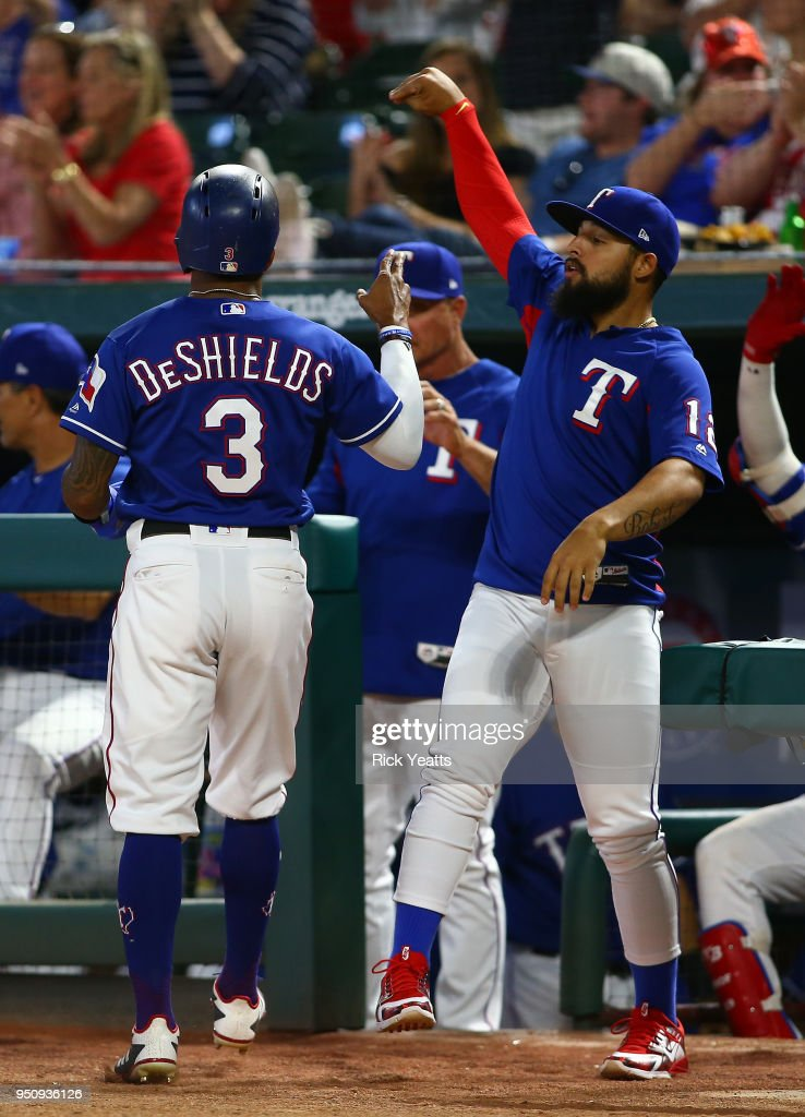 Rougned Odor #12 of the Texas Rangers congratulates Delino DeShields #3 for scoring in the sixth inning against the Oakland Athletics at Globe Life Park in Arlington on April 24, 2018 in Arlington, Texas.