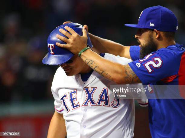 Rougned Odor of the Texas Rangers congratulates ShinSoo Choo for scoring in the third inning against the Seattle Mariners at Globe Life Park in...