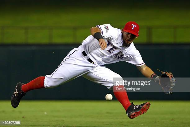 Rougned Odor of the Texas Rangers fields a diving catch in the seventh inning against the Toronto Blue Jays during game three of the American League...