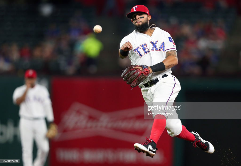 Rougned Odor #12 of the Texas Rangers fields a ground ball hit by Danny Valencia #26 of the Seattle Mariners for an out in the top of the fifth inning at Globe Life Park in Arlington on September 13, 2017 in Arlington, Texas.