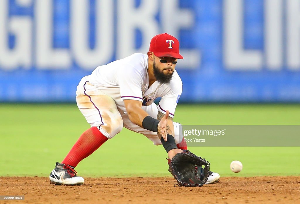 Rougned Odor #12 of the Texas Rangers fields a ground ball in the third inning against the Chicago White Sox at Globe Life Park in Arlington on August 19, 2017 in Arlington, Texas.