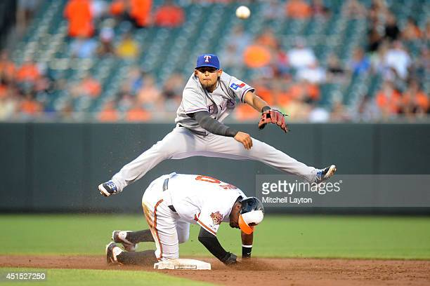 Rougned Odor of the Texas Rangers forces out Adam Jones of the Baltimore Orioles in the third inning on a ball hit by Chris Davis during a baseball...