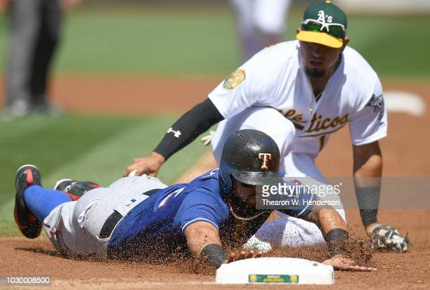 Rougned Odor of the Texas Rangers gets caught in a rundown and diving back into first base gets tagged out by Franklin Barreto of the Oakland...