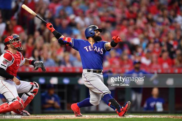 Rougned Odor of the Texas Rangers hits a grand slam home run in the fifth inning against the Cincinnati Reds at Great American Ball Park on June 14,...
