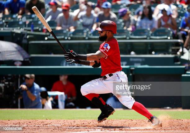 Rougned Odor of the Texas Rangers hits a run scoring single against the Cleveland Indians during the third inning at Globe Life Park in Arlington on...