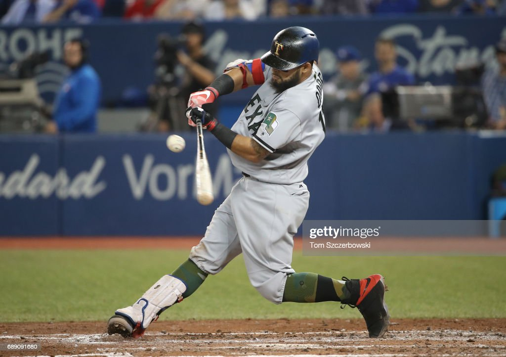 Rougned Odor #12 of the Texas Rangers hits a single in the fourth inning during MLB game action against the Toronto Blue Jays at Rogers Centre on May 27, 2017 in Toronto, Canada.