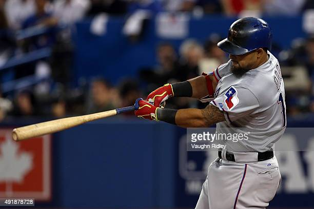 Rougned Odor of the Texas Rangers hits a solo home run against David Price of the Toronto Blue Jays in the seventh inning during game one of the...