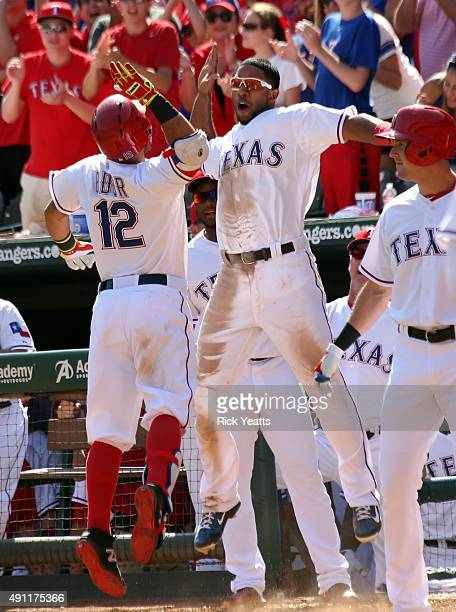 Rougned Odor of the Texas Rangers is congratulated by Elvis Andrus for hitting a solo home run in the seventh inning against the Los Angeles Angels...