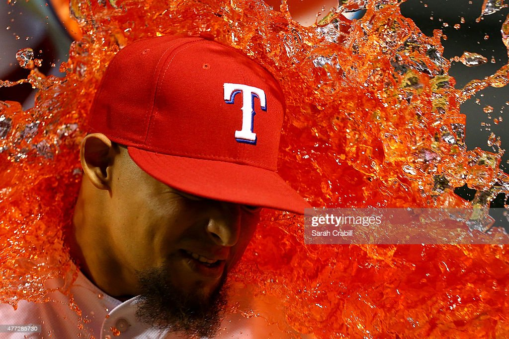 Rougned Odor #12 of the Texas Rangers is dunked with Gatorade after a game against the Los Angeles Dodgers at Globe Life Park in Arlington on June 15, 2015 in Arlington, Texas. The Texas Rangers defeated the Los Angeles Dodgers 4-1.