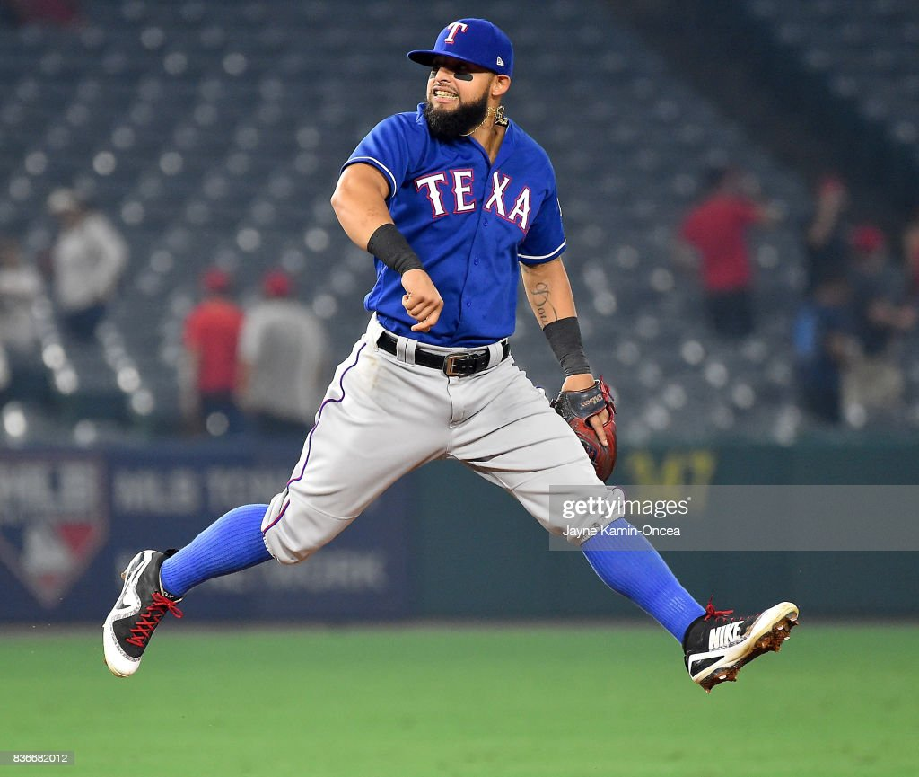 Rougned Odor #12 of the Texas Rangers leaps in the air after the final out of the ninth inning defeating the Los Angeles Angels of Anaheim at Angel Stadium of Anaheim on August 21, 2017 in Anaheim, California.
