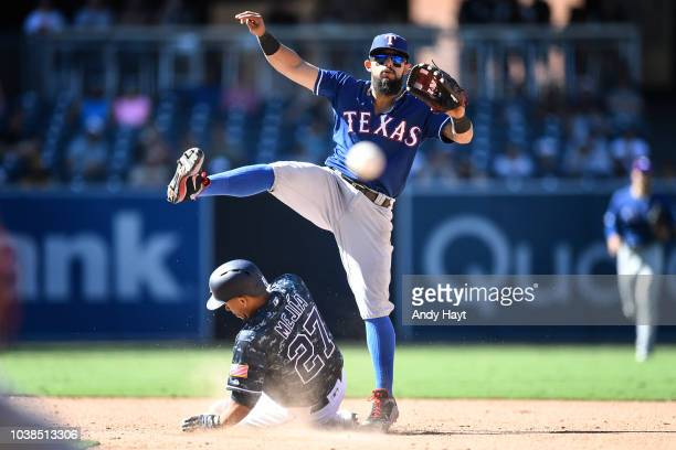 Rougned Odor of the Texas Rangers makes a double play over Franciso Mejia of the San Diego Padres during the eight inning of the game at PETCO Park...