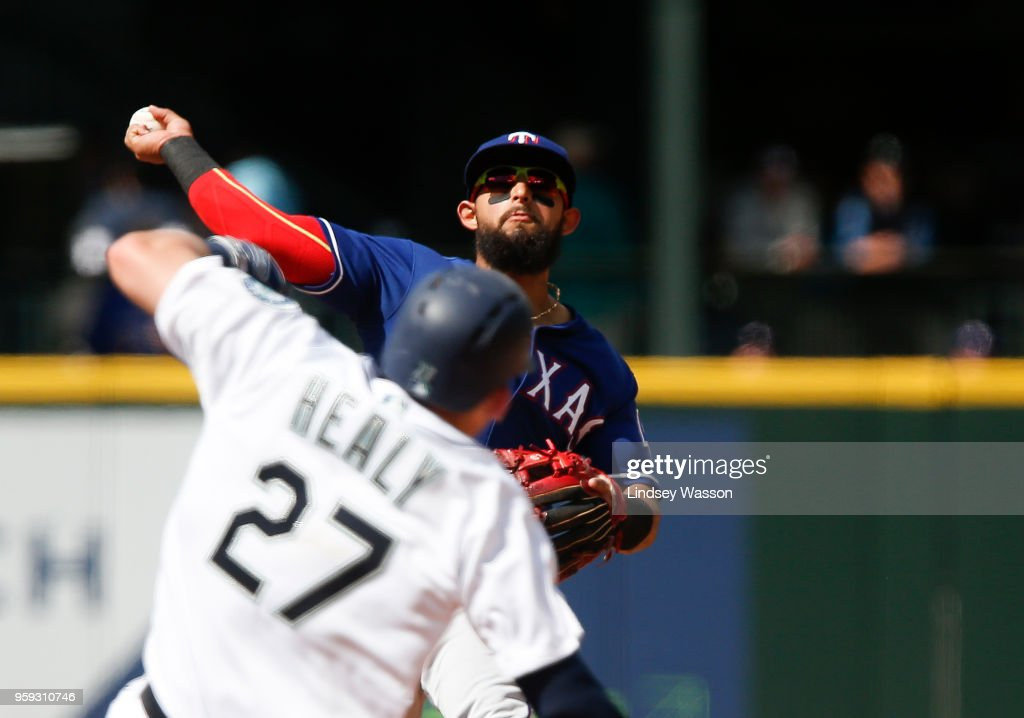 Rougned Odor #12 of the Texas Rangers makes the double play on Ryon Healy #27 of the Seattle Mariners and Ben Gamel #16 at first base to end the game at Safeco Field on May 16, 2018 in Seattle, Washington. The Texas Rangers beat the Seattle Mariners 5-1.