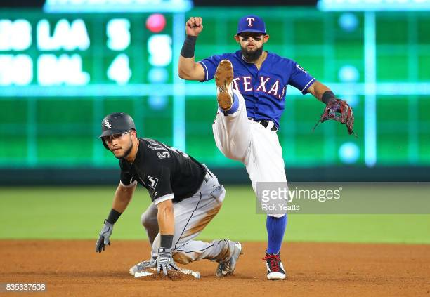 Rougned Odor of the Texas Rangers makes the out on Yolmer Sanchez throwing to first for the double play in the fourth inning at Globe Life Park in...