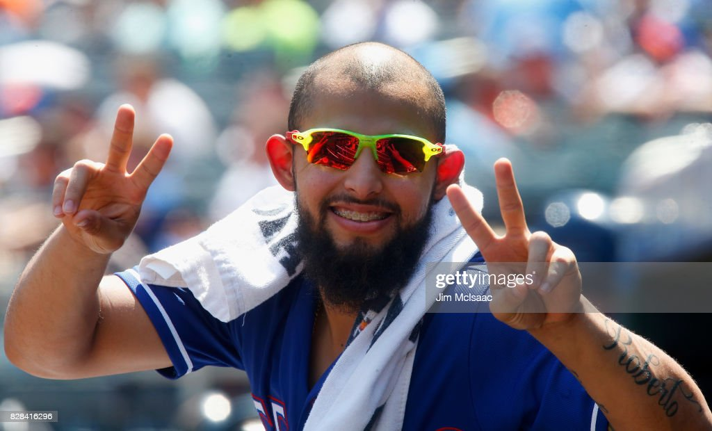 Rougned Odor #12 of the Texas Rangers poses for a photograph from the dugout during the second inning against the New York Mets at Citi Field on August 9, 2017 in the Flushing neighborhood of the Queens borough of New York City.