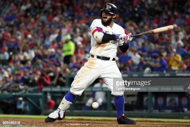 Rougned Odor of the Texas Rangers reacts after being hit by a pitch in the bottom of the fifth inning against the Boston Red Sox at Globe Life Park...