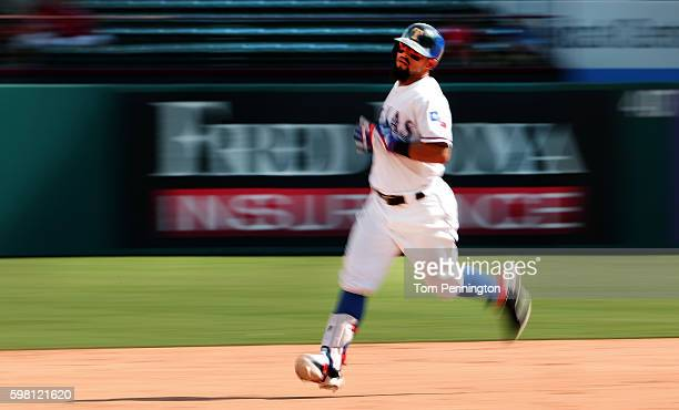 Rougned Odor of the Texas Rangers rounds the bases after hitting a threerun home run in the bottom of the eighth inning at Globe Life Park in...