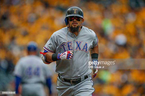 Rougned Odor of the Texas Rangers rounds the bases after hitting a solo home run against the Seattle Mariners in the sixth inning at Safeco Field on...