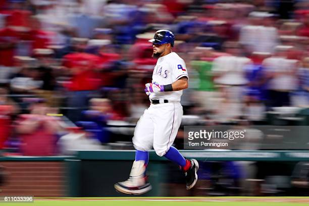 Rougned Odor of the Texas Rangers rounds the bases after hitting a two run home run against the Milwaukee Brewers in the top of the second inning at...