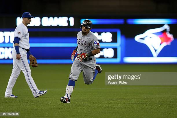 Rougned Odor of the Texas Rangers rounds the bases after scoring a solo home run against David Price of the Toronto Blue Jays in the seventh inning...
