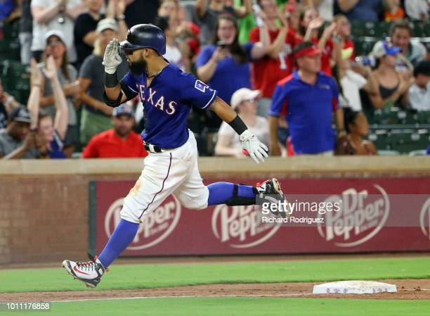 Rougned Odor of the Texas Rangers salutes as he rounds third base on the way home after a solo home run in the eighth inning against Baltimore...